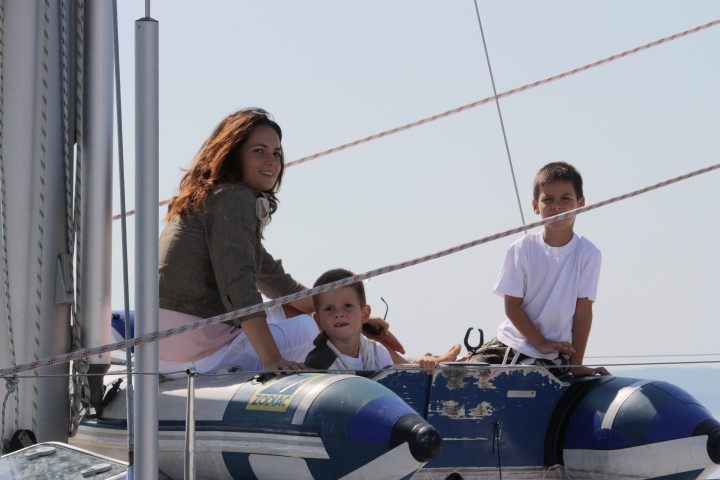 Family with children on a sailing boat in Croatia