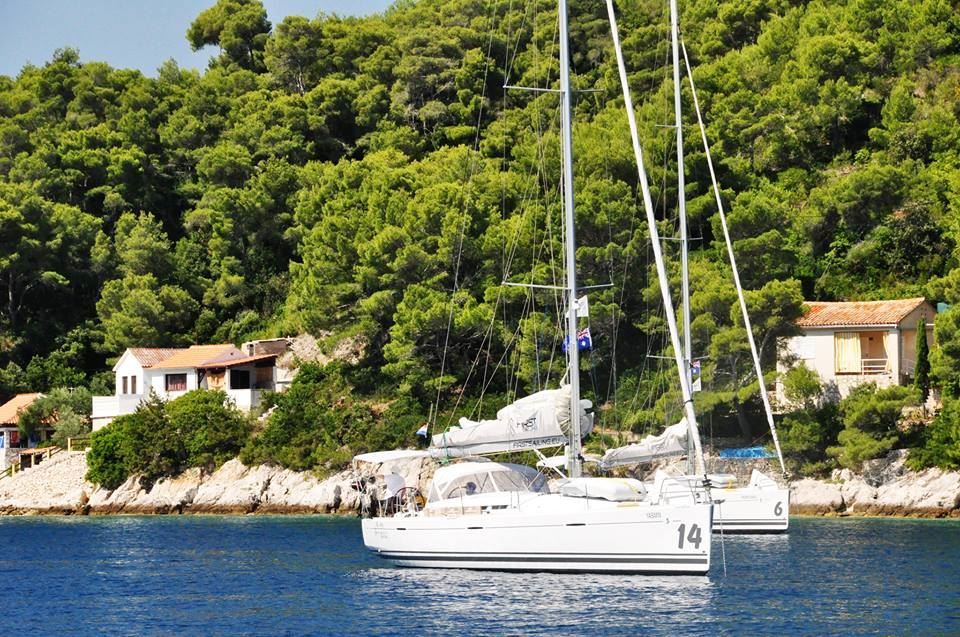 mooring in bay chartered sailing boats in Croatia